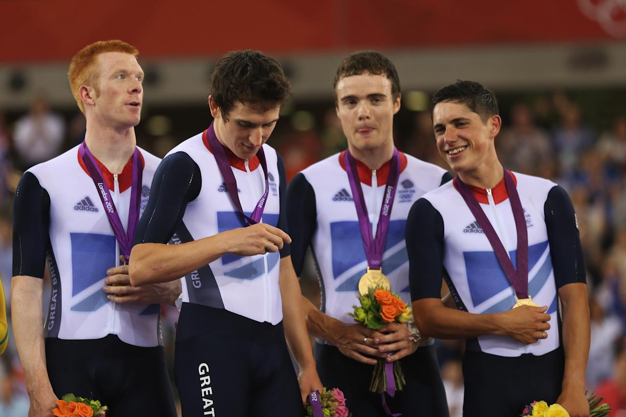 LONDON, ENGLAND - AUGUST 03:  (L-R) Edward Clancy, Geraint Thomas, Steven Burke and Peter Kennaugh of Great Britain celebrate with their gold medals during the medal ceremony for the Men's Team Pursuit Track Cycling final on Day 7 of the London 2012 Olympic Games at Velodrome on August 3, 2012 in London, England.  (Photo by Bryn Lennon/Getty Images)