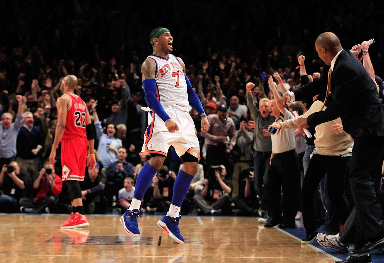 NEW YORK, NY - APRIL 08:  Carmelo Anthony #7 of the New York Knicks celebrates shooting the game game tying three pointer in the fourth quarter as Taj Gibson #22 of the Chicago Bulls looks on at Madison Square Garden on April 8, 2012 in New York City. NOTE TO USER: User expressly acknowledges and agrees that, by downloading and/or using this Photograph, user is consenting to the terms and conditions of the Getty Images License Agreement.  (Photo by Chris Trotman/Getty Images)