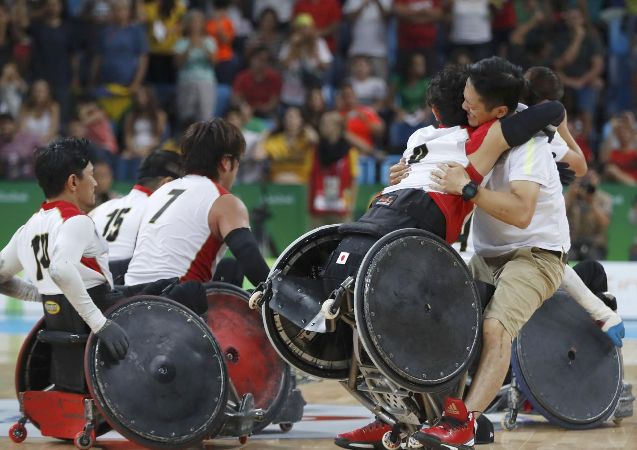 2016 Rio Paralympics - Wheelchair Rugby - Final - Mixed Team Bronze Medal Final - Japan v Canada - Carioca Arena 1 - Rio de Janeiro, Brazil - 18/09/2016. Players of Japan celebrate winning bronze medals. REUTERS/Carlos Garcia Rawlins  FOR EDITORIAL USE ONLY. NOT FOR SALE FOR MARKETING OR ADVERTISING CAMPAIGNS.