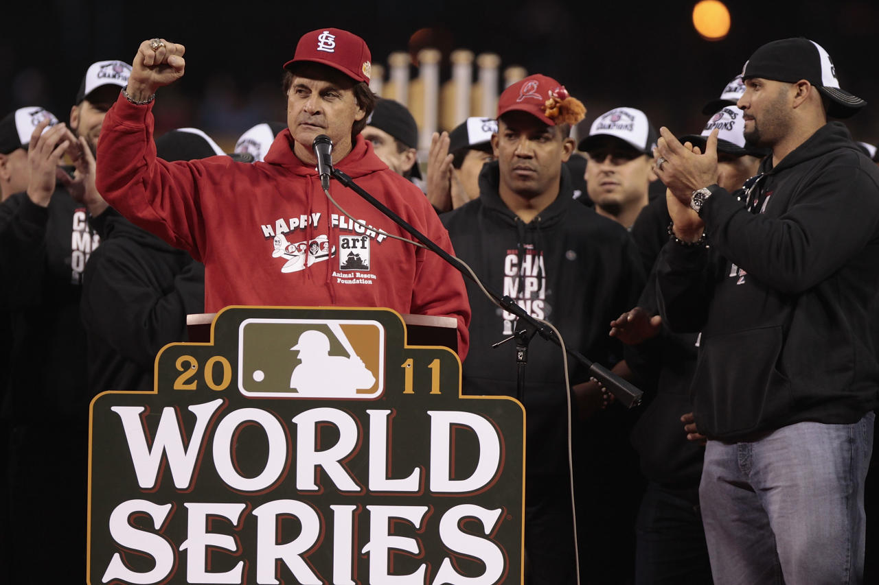 ST. LOUIS, MO - OCTOBER 30: Manager Tony La Russa (L-R) speaks to fans as Octavio Dotel and Albert Pujols of the St. Louis Cardinals look on during a ceremony celebrating the team's 11th World Series championship October 30, 2011 at Busch Stadium in St. Louis, Missouri. (Photo by Whitney Curtis/Getty Images)