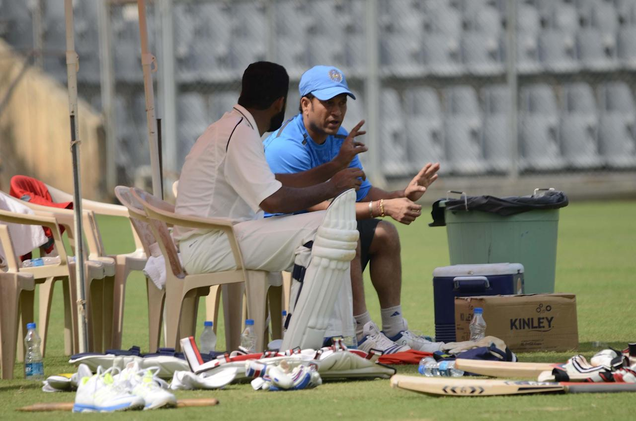 Master Blaster Sachin Tendulkar with Wasim Jaffer during practice session at Wankhede stadium ahead of his last Ranji Trophy match for Mumbai against Haryana in Lahli, Rohtak in Mumbai on Oct.24, 2013. (Photo: Sandeep Mahankaal/IANS)