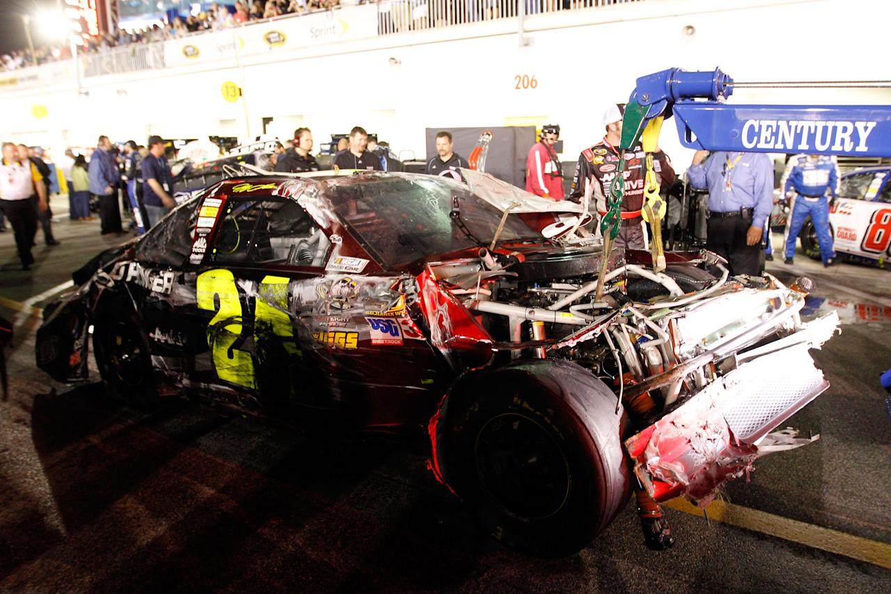 DAYTONA BEACH, FL - FEBRUARY 18: Jeff Gordon, driver of the #24 Drive to End Hunger Chevrolet, is towed in the garage after flipping during an on track incident during the NASCAR Budweiser Shootout at Daytona International Speedway on February 18, 2012 in Daytona Beach, Florida.  (Photo by Chris Graythen/Getty Images)