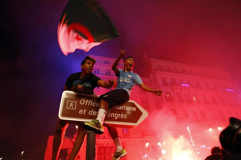 Algerian soccer fans celebrate after their team qualified for the World Cup, in Marseille, southern France, Thursday, June 26, 2014. Algeria drew with Russia 1-1, and advanced to the round of 16 for the first time in their World Cup history