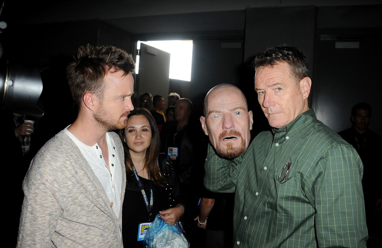 """Aaron Paul and Bryan Cranston speak onstage at the """"Breaking Bad"""" panel during Comic-Con International 2013 at San Diego Convention Center on July 21, 2013 in San Diego, California."""