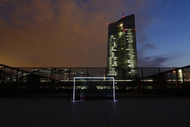 A photograph taken using long exposure shows a goalpost which has been illuminated with torches at a leisure facility in front of the ECB headquarters in Frankfurt