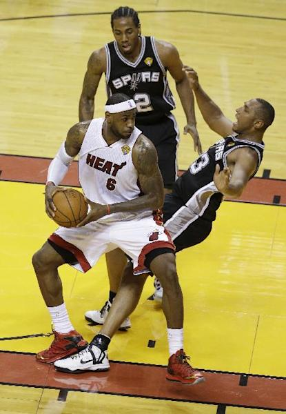 Just about everything fell right for the Spurs, to the chagrin of LeBron James and the Heat. (AP)