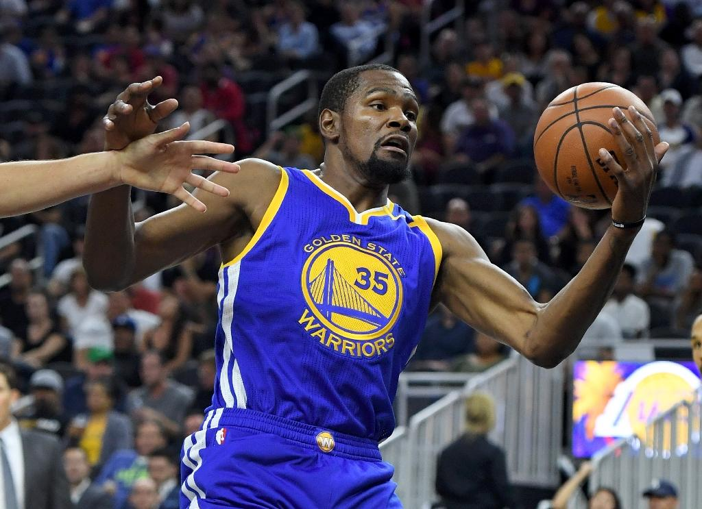 After losing 2015's NBA Finals to Cleveland, the Golden State Warriors toughened their lineup by adding Kevin Durant to their roster (AFP Photo/Ethan Miller)