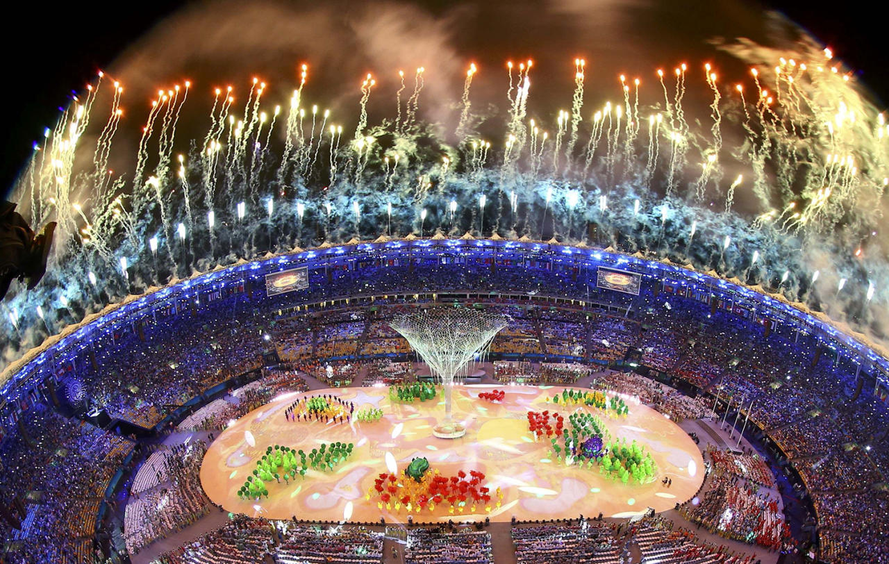 <p>Fireworks explode during the closing ceremony at the 2016 Rio Olympics. (REUTERS/Pawel Kopczynski) </p>