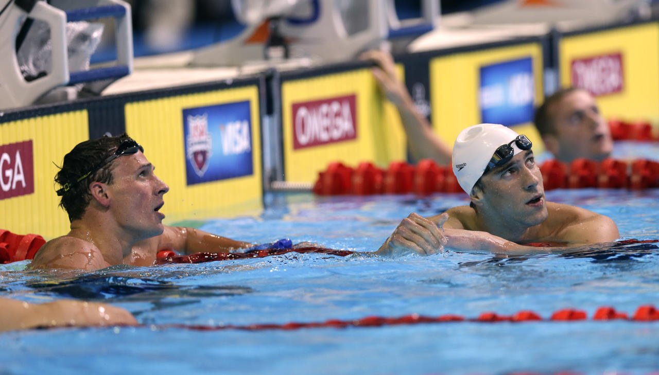 Ryan Lochte, left, and Michael Phelps look at the time after finishing in the men's 400-meter individual medley final at the U.S. Olympic swimming trials, Monday, June 25, 2012, in Omaha, Neb. (AP Photo/David Phillip)