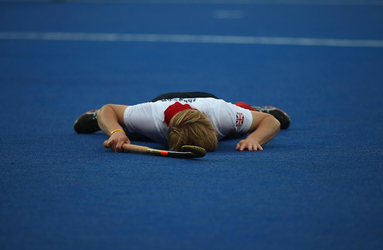 LONDON, ENGLAND - JULY 30:  Ashley Jackson of Great Britain lays on the floor after missing a shot on goal during the Men's Hockey Match between Great Britain and Argentina on Day 3 of the London 2012 Olympic Games at the Riverbank Arena on July 30, 2012 in London, England.  (Photo by Daniel Berehulak/Getty Images)