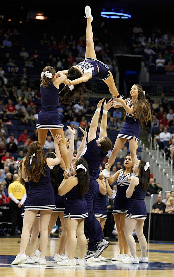 The Georgetown Hoyas cheerleading squad preforms during the second round of the 2012 NCAA Men's Basketball Tournament between the Hoyas and the Belmont Bruins at Nationwide Arena on March 16, 2012 in Columbus, Ohio.  (Photo by Rob Carr/Getty Images)