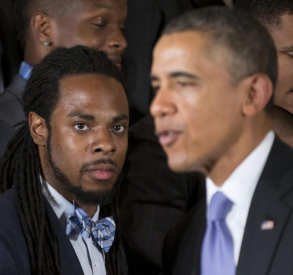 Seattle Seahawks cornerback Richard Sherman listens as President Barack Obama speaks in the East Room of the White House in Washington, Wednesday, May 21, 2014, during a ceremony where the president honored the NFL Super Bowl champion Seattle Seahawks football team. The Seahawks defeated the Denver Broncos in Super Bowl XLVIII. (AP Photo/Pablo Martinez Monsivais)