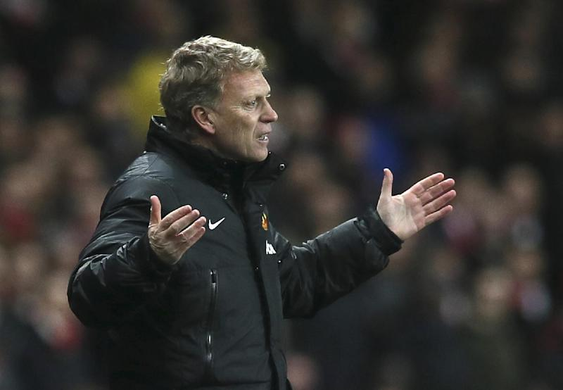 """In this Wednesday, Feb. 12, 2014 file photo Manchester United's manager David Moyes gestures to his team during their English Premier League soccer match between Arsenal and Manchester United at the Emirates stadium in London. Manchester United says manager David Moyes has left the Premier League club after less than a year in charge, amid heavy speculation he was about to be fired. United released a brief statement in its website Tuesday, saying the club """"would like to place on record its thanks for the hard work, honesty and integrity he brought to the role."""""""