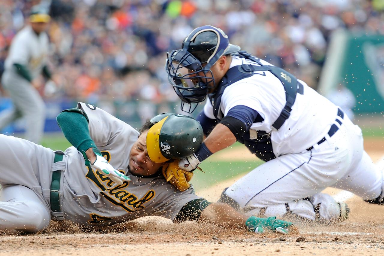 DETROIT, MI - OCTOBER 07:  Coco Crisp #4 of the Oakland Athletics is tagged out at home Gerald Laird #9 of the Detroit Tigers in the top of the third inning during Game Two of the American League Division Series at Comerica Park on October 7, 2012 in Detroit, Michigan.  (Photo by Jason Miller/Getty Images)