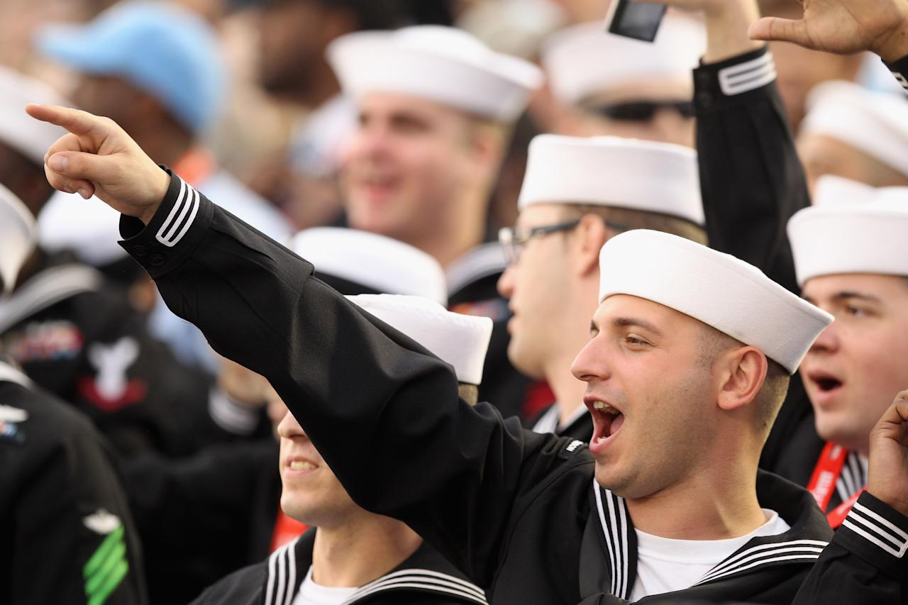 CORONADO, CA - NOVEMBER 11:  U.S. Military personnel cheer during the North Carolina Tar Heels game against the Michigan State Spartans during the Quicken Loans Carrier Classic on board the USS Carl Vinson on November 11, 2011 in Coronado, California.  (Photo by Ezra Shaw/Getty Images)