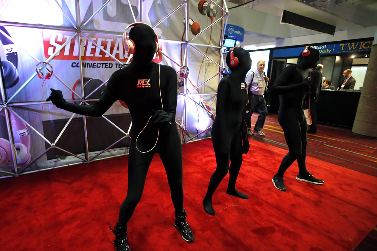 Dancers perform at the MTX Audio booth at the International Consumer Electronics Show.