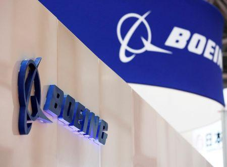 Boeing sacks hundreds of engineers, stock jumps