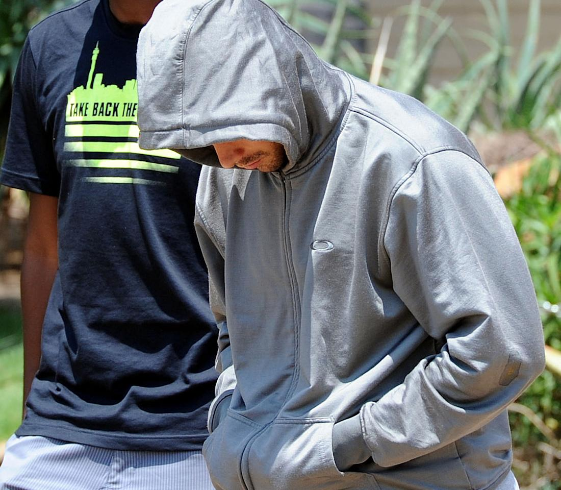 Olympic athlete Oscar Pistorius leaves the Boschkop police station, east of Pretoria, South Africa, Thursday, Feb. 14, 2013 en route to appear in court charged with murder. Pistorius was charged Thursday for the Valentine's Day murder of his girlfriend, model Reeva Steenkamp, in South Africa's capital, Pretoria. (AP Photo/Chris Collingridge) SOUTH AFRICA OUT