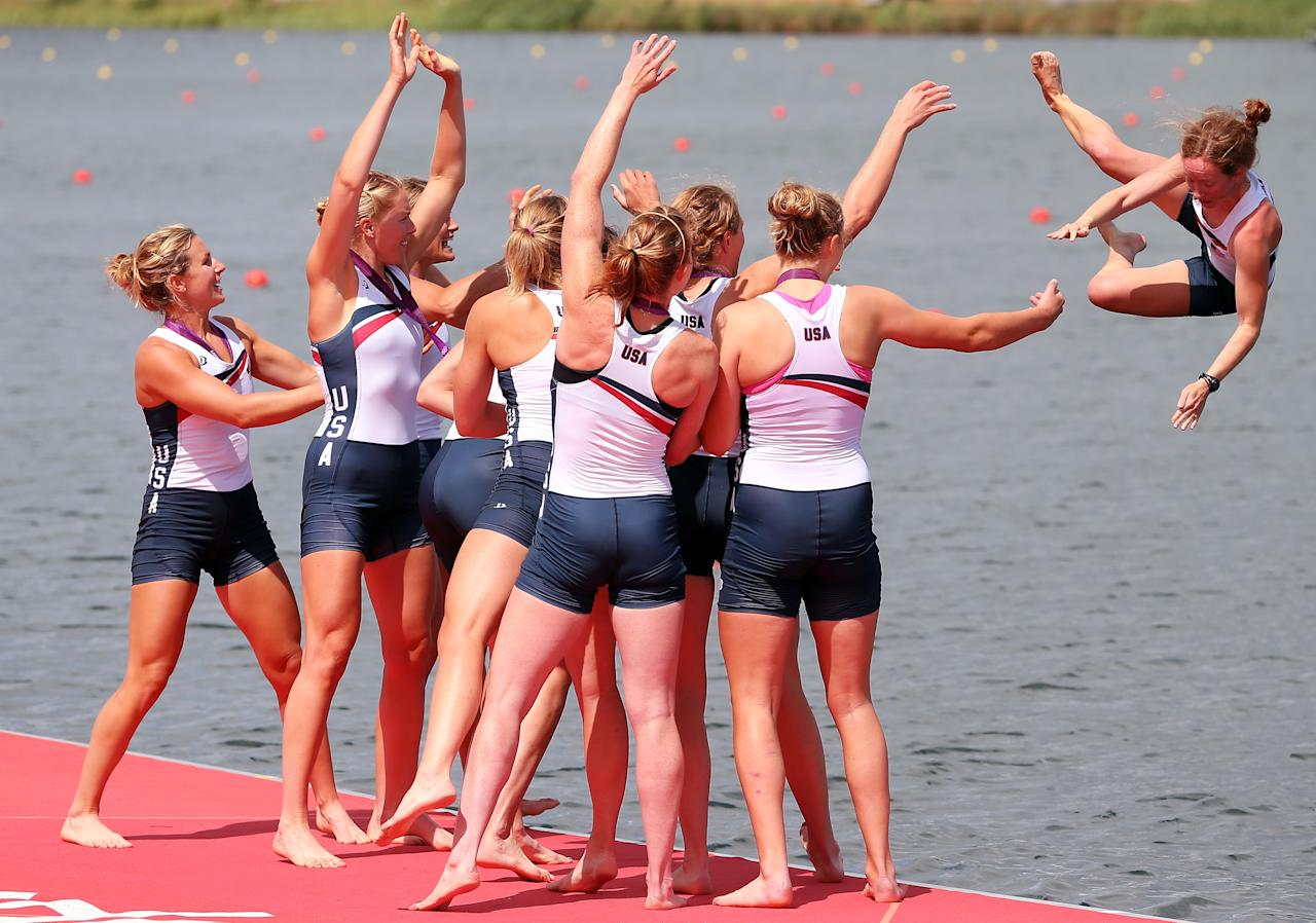 WINDSOR, ENGLAND - AUGUST 02:  The United States team throw their cox Mary Whipple into the water as they celebrate with their gold medals during the medal ceremony after the Women's Eight final on Day 6 of the London 2012 Olympic Games at Eton Dorney on August 2, 2012 in Windsor, England.  (Photo by Ezra Shaw/Getty Images)