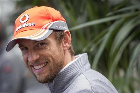 McLaren Formula One driver Button smiles while giving an interview at the Circuit of The Americas in Austin