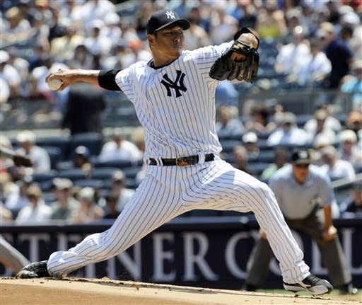 New York Yankees starter Hiroki Kuroda delivers a pitch to the Chicago White Sox during the first inning of a baseball game Saturday, June 30, 2012, at Yankee Stadium in New York. Kuroda struck out 11 and got the win as the Yankees defeated the White Sox 4-0. (AP Photo/Bill Kostroun)