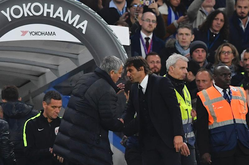 Manchester United's manager Jose Mourinho (L) talks to Chelsea head coach Antonio Conte after the final whistle at Stamford Bridge in London on October 23, 2016