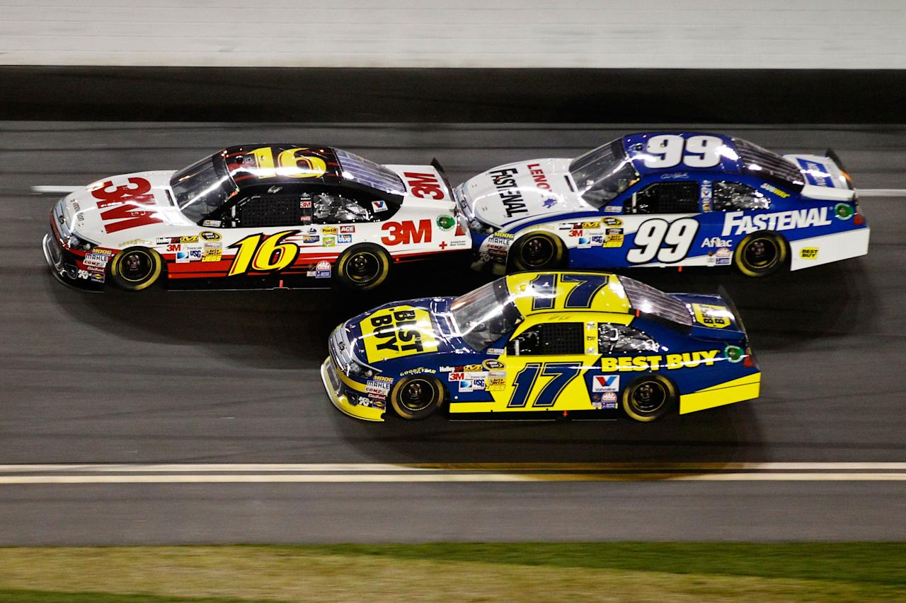 DAYTONA BEACH, FL - FEBRUARY 27:  Greg Biffle, driver of the #16 3M Ford, Carl Edwards, driver of the #99 Fastenal Ford, and Matt Kenseth, driver of the #17 Best Buy Ford, race during the NASCAR Sprint Cup Series Daytona 500 at Daytona International Speedway on February 27, 2012 in Daytona Beach, Florida.  (Photo by Streeter Lecka/Getty Images)