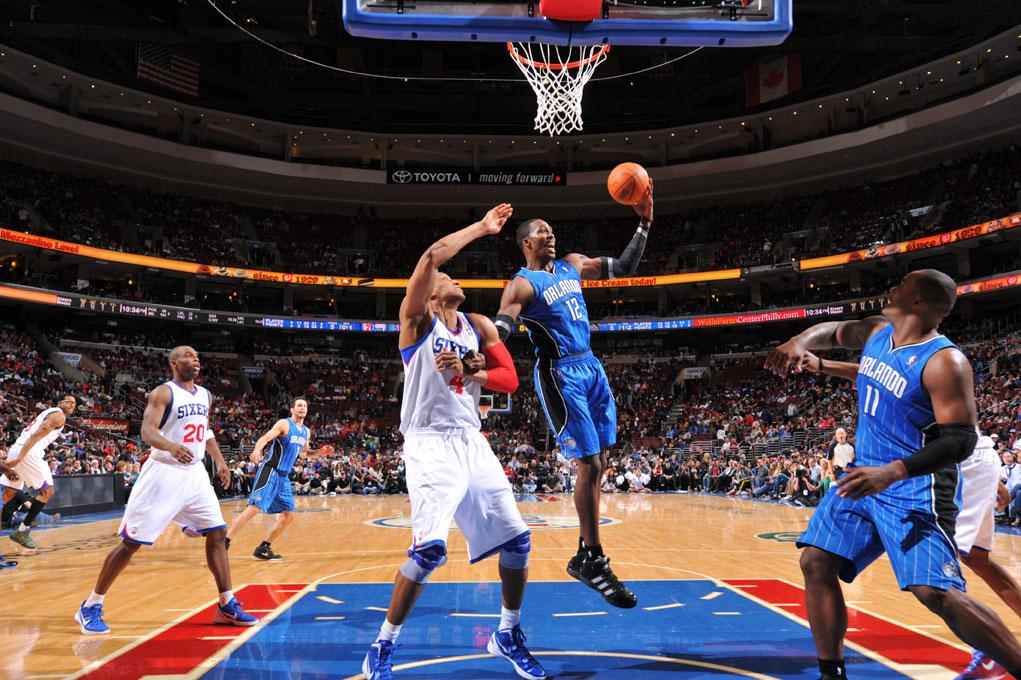 PHILADELPHIA, PA - APRIL 7:  Dwight Howard #12 of the Orlando Magic grabs a rebound against Tony Battie #4 of the Philadelphia 76ers on April 7, 2012 at the Wells Fargo Center in Philadelphia, Pennsylvania.    NOTE TO USER: User expressly acknowledges and agrees that, by downloading and/or using this Photograph, user is consenting to the terms and conditions of the Getty Images License Agreement. Mandatory Copyright Notice: Copyright 2012 NBAE