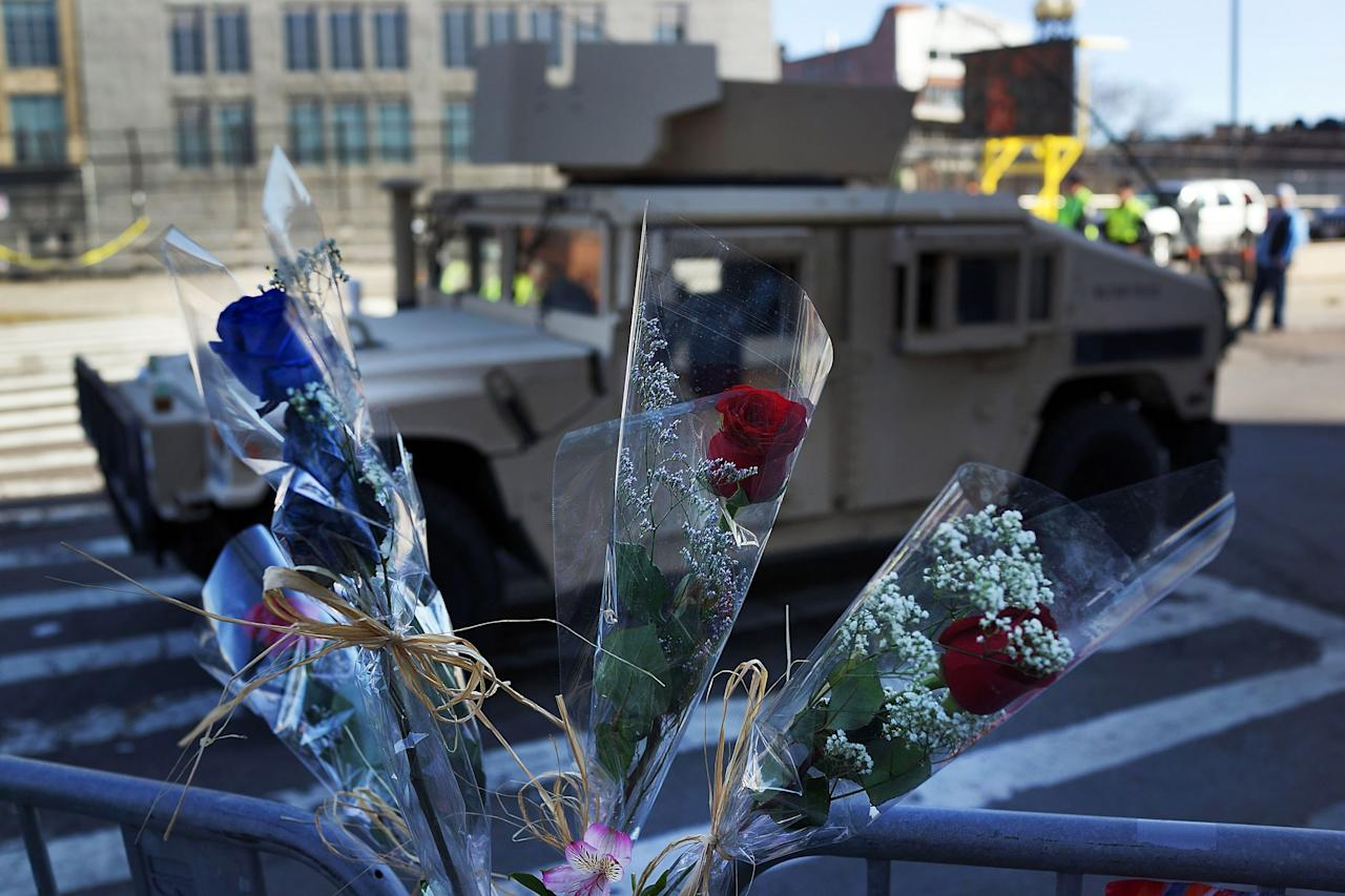 BOSTON, MA - APRIL 17: Flowers are placed beside a National Guardsman's vehicle near the scene of twin bombings at the Boston Marathon on April 17, 2013 in Boston, Massachusetts. The explosions, which occurred near the finish line of the 116-year-old Boston race on April 15, resulted in the deaths of three people with more than 170 others injured. Security has been heightened across the nation as the search continues for the person or people behind the bombings.  (Photo by Spencer Platt/Getty Images)