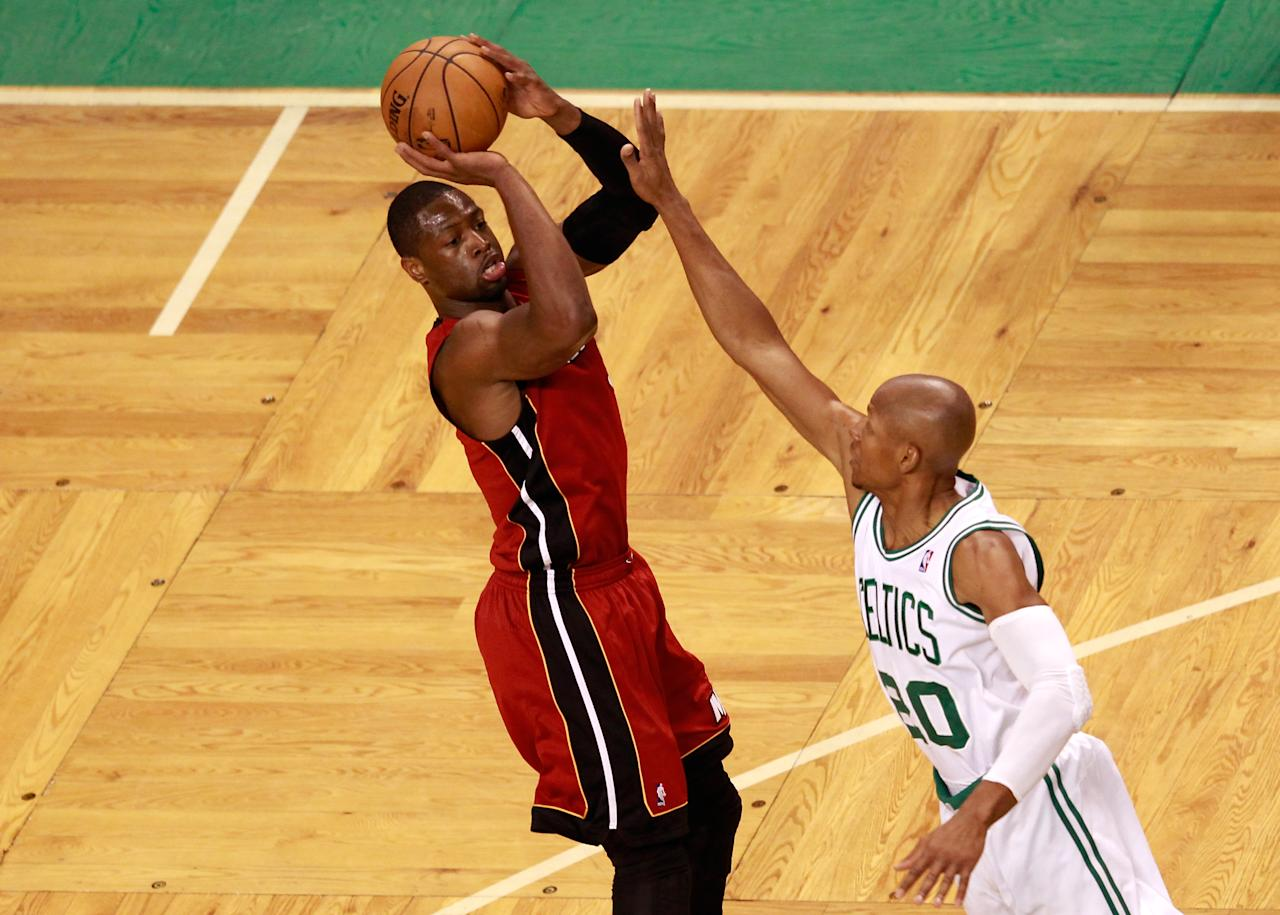 BOSTON, MA - JUNE 07:  Dwyane Wade #3 of the Miami Heat attempts a shot in the first quarter against Ray Allen #20 of the Boston Celtics in Game Six of the Eastern Conference Finals in the 2012 NBA Playoffs on June 7, 2012 at TD Garden in Boston, Massachusetts. NOTE TO USER: User expressly acknowledges and agrees that, by downloading and or using this photograph, User is consenting to the terms and conditions of the Getty Images License Agreement.  (Photo by Jared Wickerham/Getty Images)