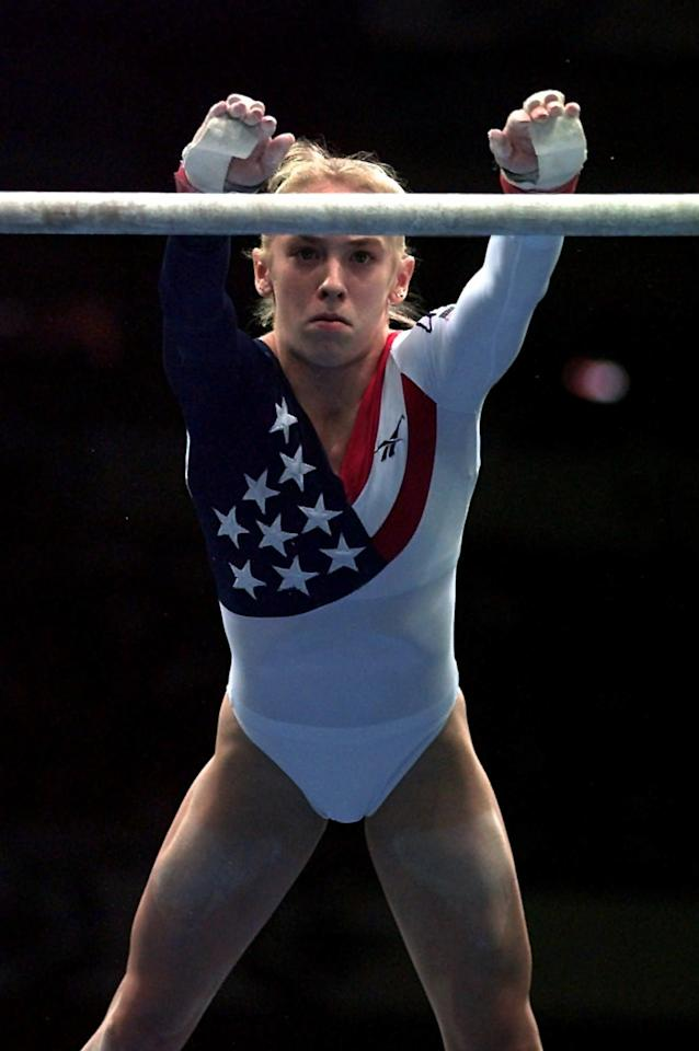 Jaycie Phelps of the United States performs her routine on the uneven bars during the women's team gymnastics competition at the Centennial Summer Olympic Games in Atlanta on Tuesday, July 23, 1996.   (AP Photo/Amy Sancetta)