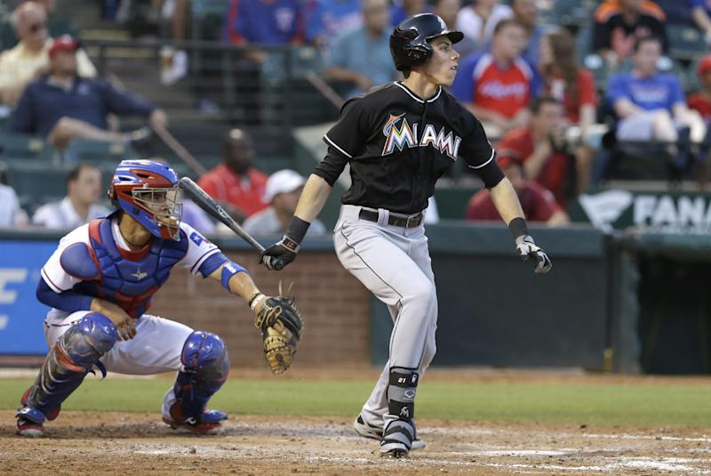 Marlins beat Texas 8-5 for 13th win in a row vs AL