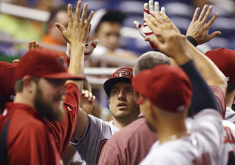 Hill, Pennington lead D-Backs past Marlins, 3-2