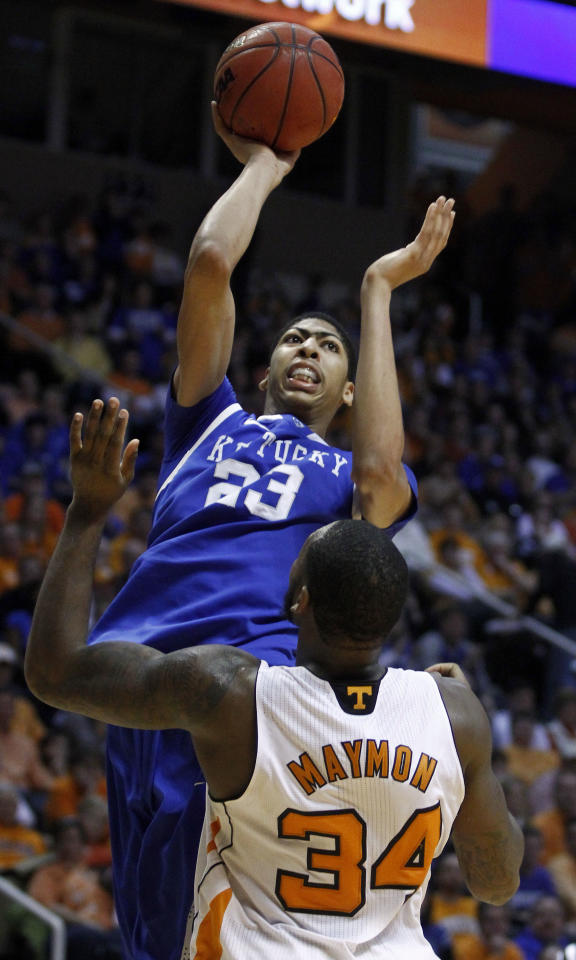 Kentucky's Anthony Davis (23) shoots over Tennessee's Jeronne Maymon (34) in the second half of an NCAA college basketball game on Saturday, Jan. 14, 2012, in Knoxville, Tenn. Kentucky won 65-62. (AP Photo/Wade Payne)