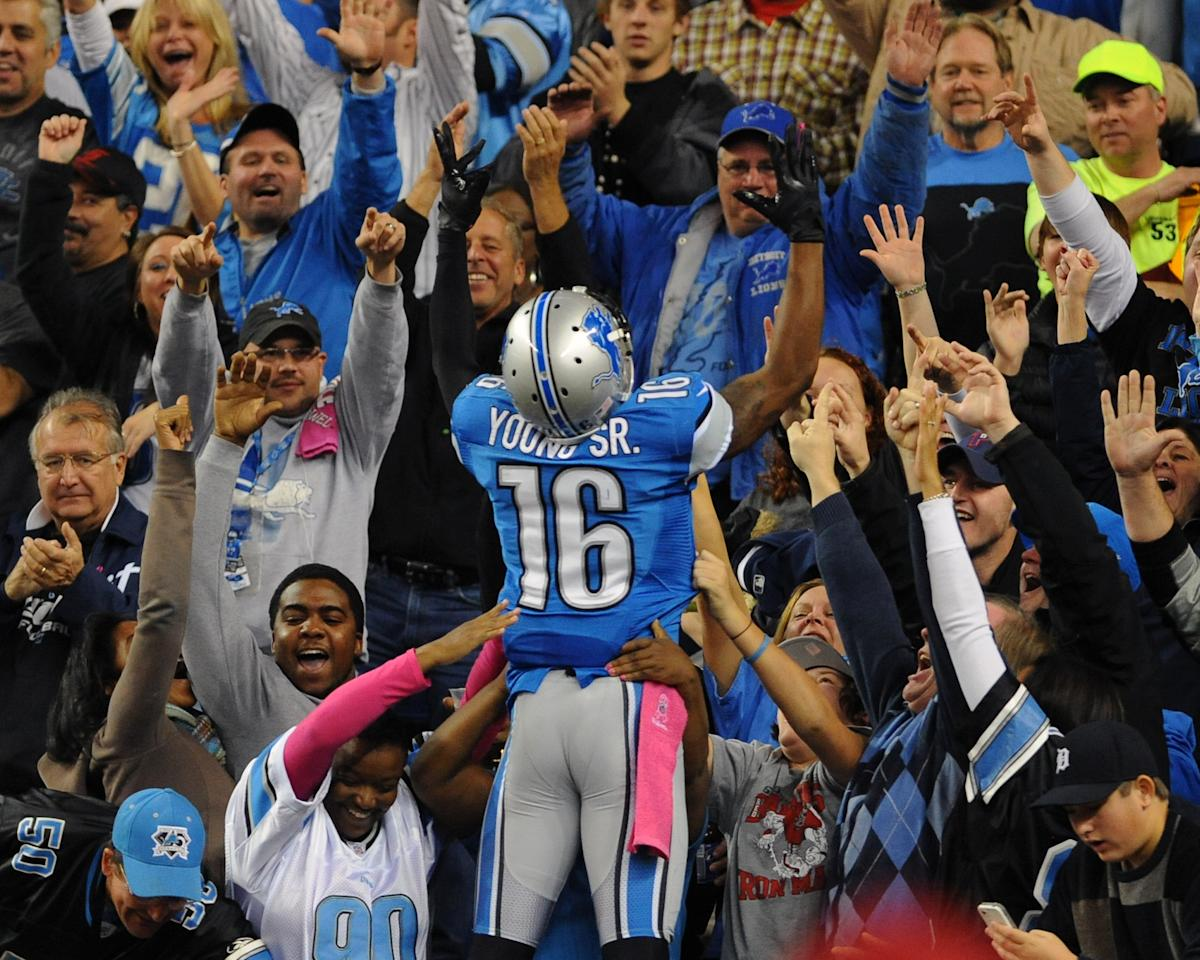 DETROIT, MI - OCTOBER 28:  Wide receiver Titus Young #16 of the Detroit Lions jumps into the stands to celebrate a touchdown catch in the second quarter against the Seattle Seahawks October 28, 2012 at Ford Field in Detroit, Michigan.  (Photo by Al Messerschmidt/Getty Images)