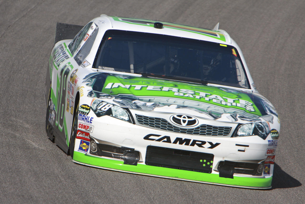 Kyle Busch drives his car during practice for Sunday's NASCAR Ford 400 Sprint Cup series auto race at Homestead-Miami Speedway in Homestead, Fla., Saturday, Nov. 19, 2011. (AP Photo/Darryl Graham)