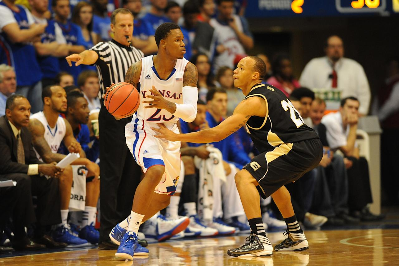 October 30, 2012; Lawrence, KS, USA; Kansas Jayhawks guard Ben McLemore (23) looks to pass as Emporia State Hornets guard Terrence Moore (21) defends in the second half at Allen Fieldhouse. The Jayhawks won 88-54. Mandatory Credit: Denny Medley-US PRESSWIRE