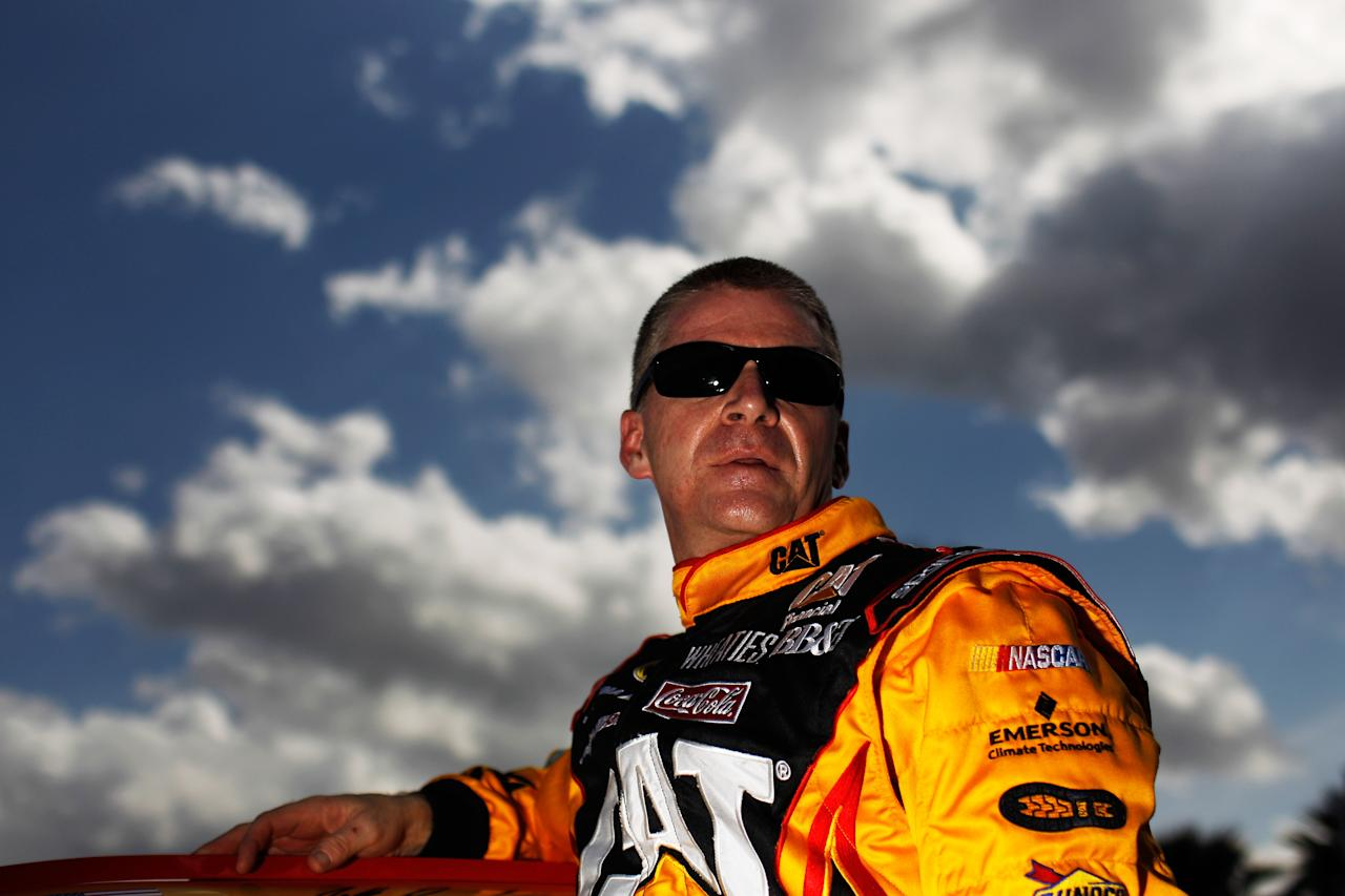 DAYTONA BEACH, FL - FEBRUARY 19:  Jeff Burton, driver of the #31 Caterpillar Chevrolet, climbs from his car after qualifying for the NASCAR Sprint Cup Series Daytona 500 at Daytona International Speedway on February 19, 2012 in Daytona Beach, Florida.  (Photo by Tom Pennington/Getty Images for NASCAR)