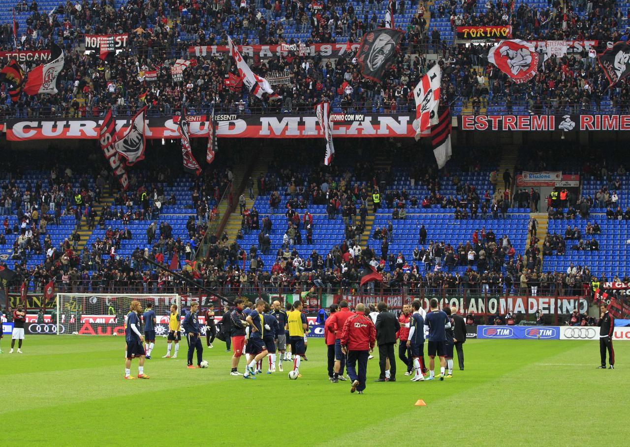 Players stand after the decision to suspend the Serie A soccer match between AC Milan and Genoa, at the San Siro stadium in Milan, Italy, Saturday, April 14, 2012. The Italian football federation has called off all league games this weekend after the death of Livorno midfielder Piermario Morosini during a Serie B match against Pescara, in Pescara, central Italy, Saturday, April 14, 2012. (AP Photo/Luca Bruno)