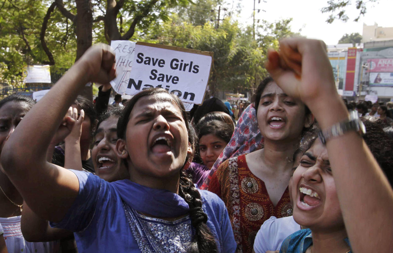 Indian students shout slogans during a protest rally in Hyderabad, India, Monday, Dec. 31, 2012. The gang-rape and killing of a New Delhi student has set off an impassioned debate about what India needs to do to prevent such a tragedy from happening again. The country remained in mourning Monday, two days after the 23-year-old physiotherapy student died from her internal wounds in a Singapore hospital. (AP Photo/Mahesh Kumar A.)
