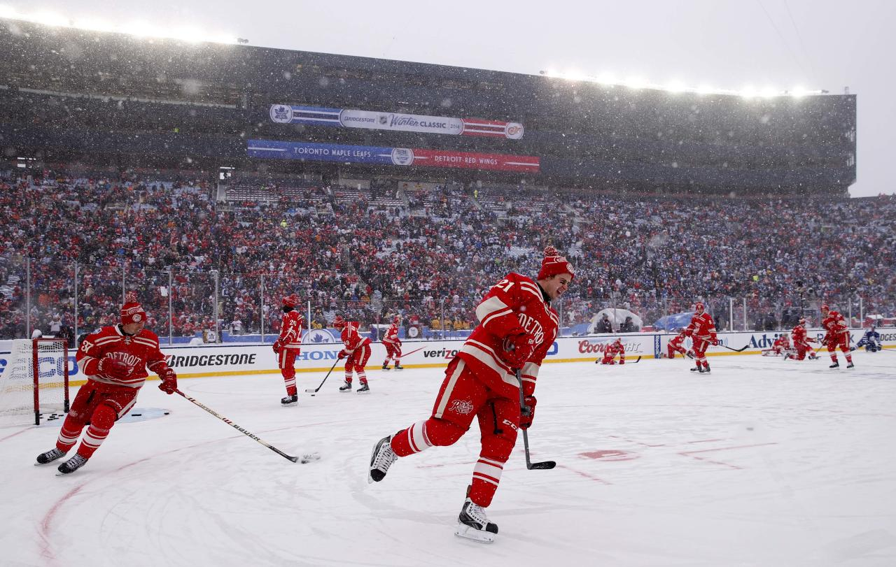 Jan 1, 2014; Ann Arbor, MI, USA; Detroit Red Wings players warm up before the 2014 Winter Classic hockey game against the Toronto Maple Leafs at Michigan Stadium. (Rick Osentoski-USA TODAY Sports)