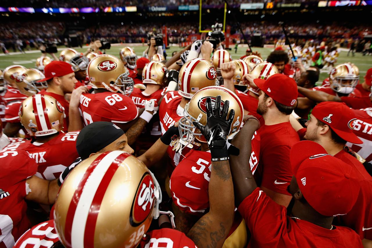 The San Francisco 49ers huddle up prior to the start of Super Bowl XLVII against the Baltimore Ravens at the Mercedes-Benz Superdome on February 3, 2013 in New Orleans, Louisiana.  (Photo by Chris Graythen/Getty Images)