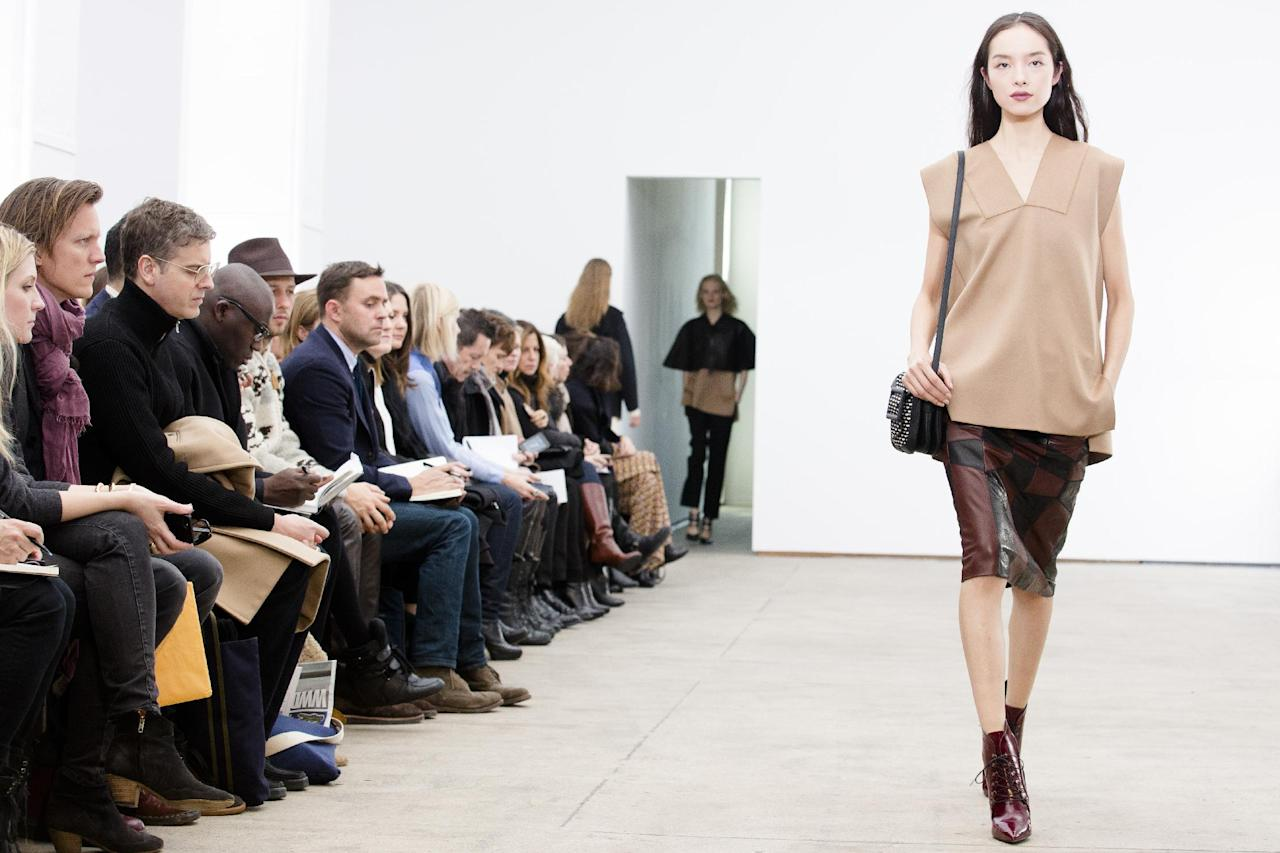 A model walks the runway during the Derek Lam Fall 2013 fashion show during Fashion Week, Sunday, Feb. 10, 2013, in New York. (AP Photo/John Minchillo)