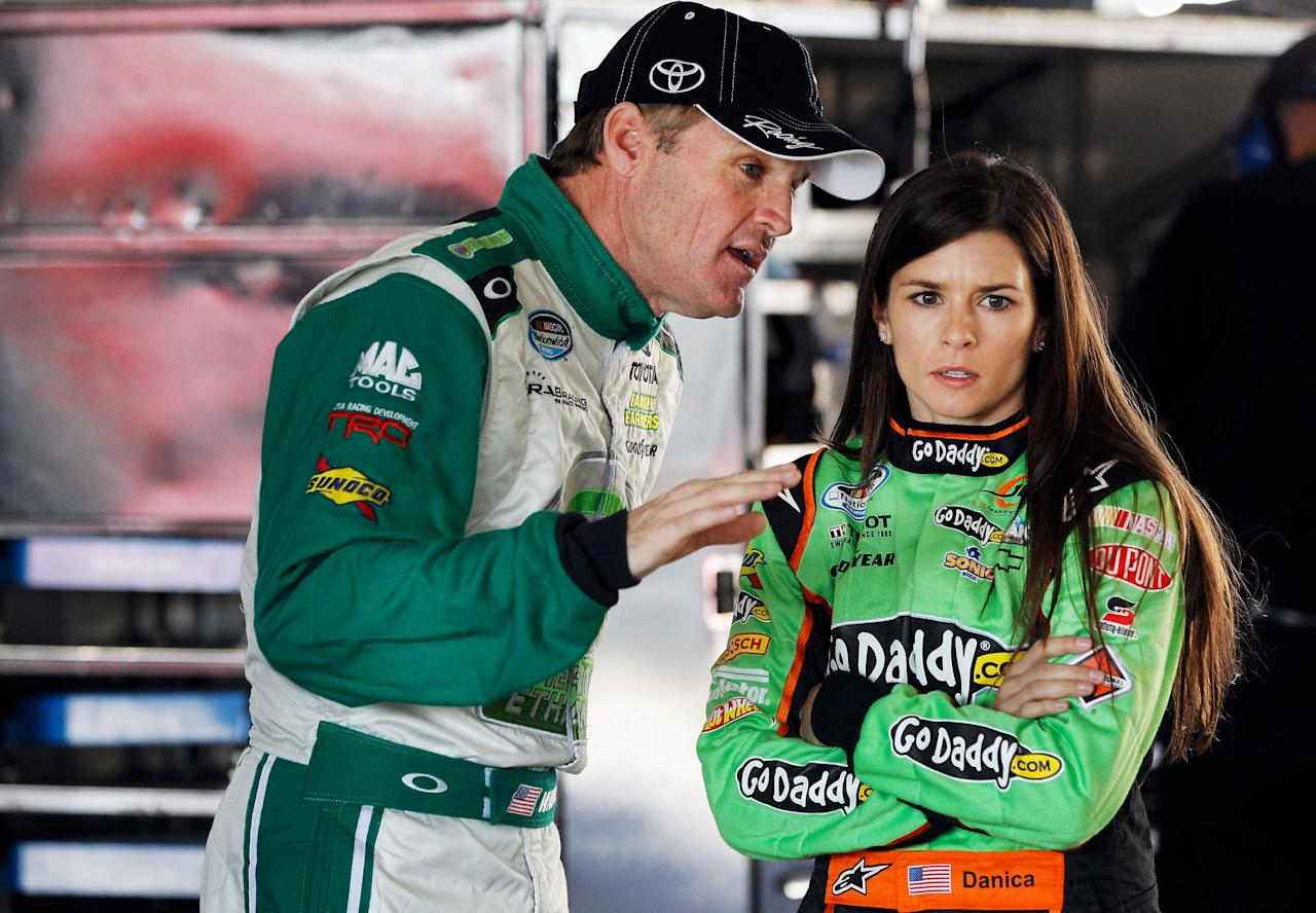 HOMESTEAD, FL - NOVEMBER 16:  (L-R) Kenny Wallace, driver of the #99 Toyota Toyota, talks with Danica Patrick, driver of the #7 GoDaddy.com Chevrolet, during practice for the NASCAR Nationwide Series Ford EcoBoost 300 at Homestead-Miami Speedway on November 16, 2012 in Homestead, Florida.  (Photo by Tom Pennington/Getty Images)