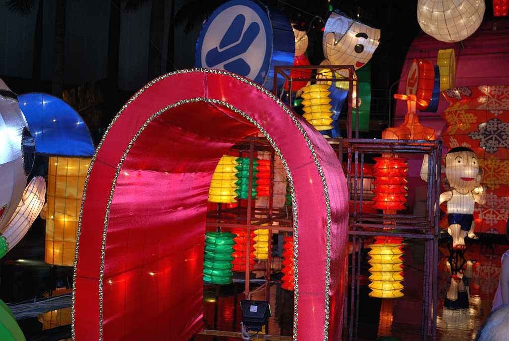 We take a ferry from Hong Kong to reach brightly lit Kowloon. Giving bright competition to the Symphony of Lights is a carnival of lanterns.
