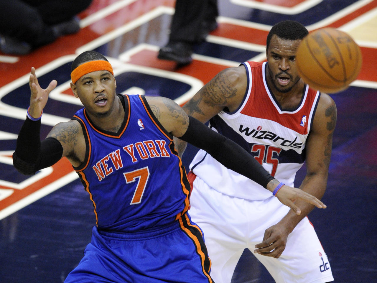 New York Knicks forward Carmelo Anthony (7) looks for the ball against Washington Wizards forward Trevor Booker (35) during the second half of an NBA basketball game on Friday, Jan. 6, 2012, in Washington. The Knicks won 99-96. (AP Photo/Nick Wass)