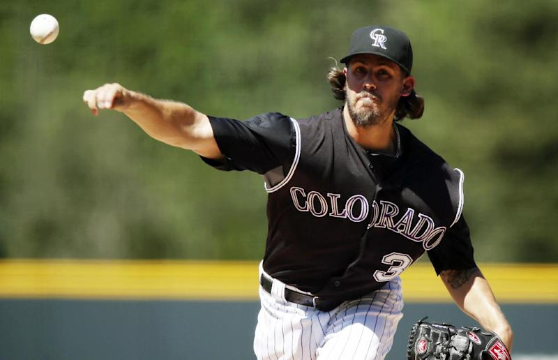 Bergman earns 1st win as Rockies beat Marlins 7-4