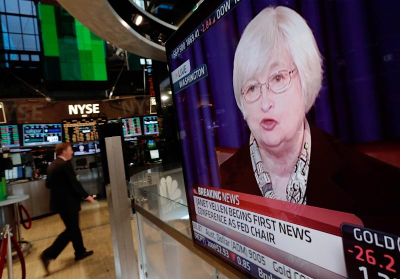 Yellen's tightrope walk in first Q&A as Fed chair
