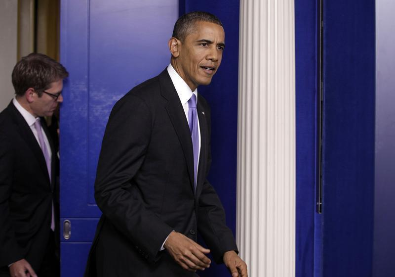 U.S. President Barack Obama walks into the briefing room of the White House in Washington
