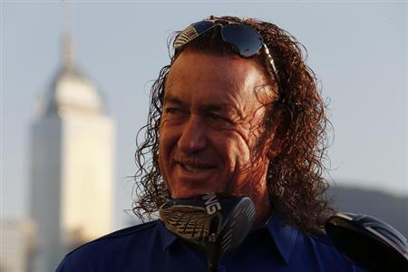 Spain's Miguel Angel Jimenez poses after being selected as the playing captain for Team Europe for the inaugural EurAsia Cup, at a news conference in Hong Kong